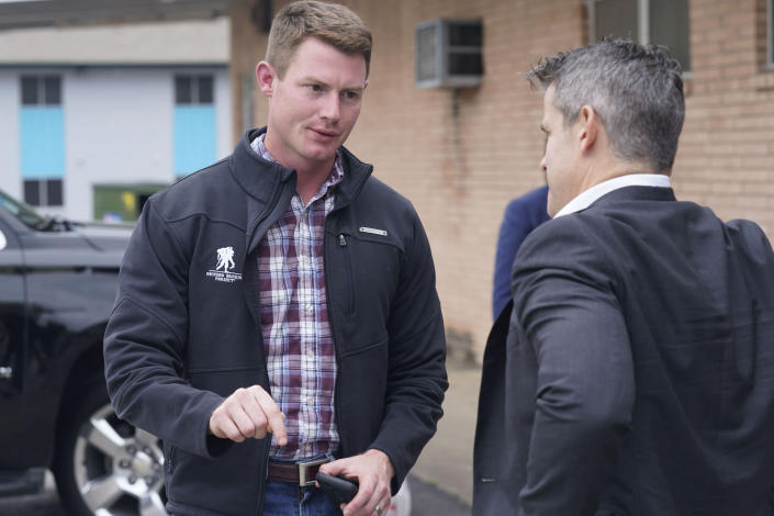 Texas congressional candidate Michael Wood, left, talks with Rep. Adam Kinzinger, R-Ill., Tuesday, April 27, 2021, in Arlington, Texas. Wood is considered the anti-Trump Republican Texas congressional candidate that Kinzinger has endorsed in the May 1st special election for the 6th Congressional District. (AP Photo/LM Otero)