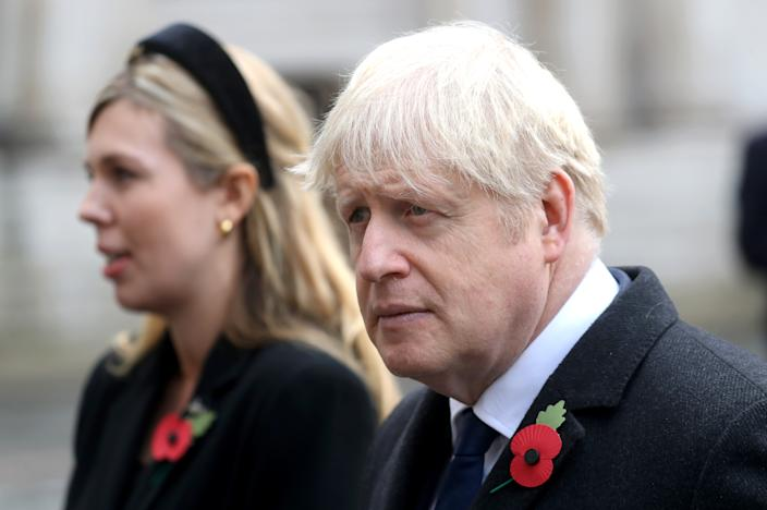 Britain's prime minister Boris Johnson with partner Carrie Symonds at the National Service of Remembrance at the Cenotaph on Sunday. Photo: Chris Jackson/WPA Pool/Getty Images