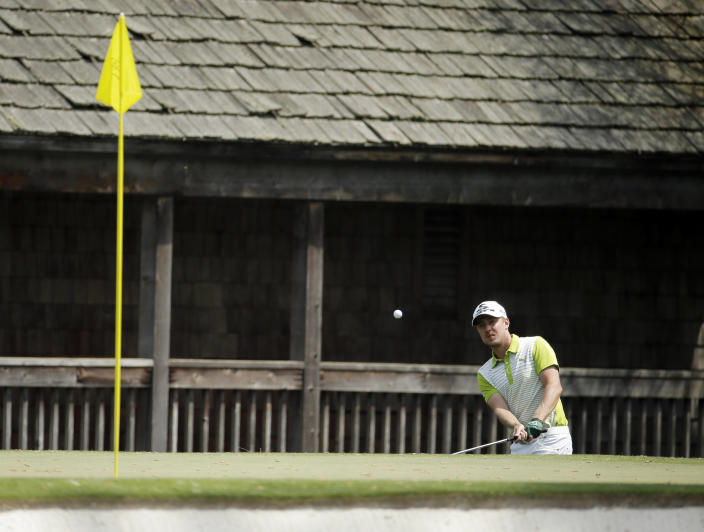 Jonas Blixt, of Sweden, hits out of a bunker on the 11th fairway during the second round of the Masters golf tournament Friday, April 11, 2014, in Augusta, Ga. (AP Photo/Charlie Riedel)