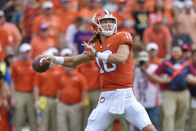 FILE - In this Oct. 12, 2019, file photo, Clemson's Trevor Lawrence throws a pass during the first half of an NCAA college football game against Florida State, in Clemson, S.C. Lawrence has not thrown an interception in his last four games to go with 13 touchdown passes. (AP Photo/Richard Shiro, File)