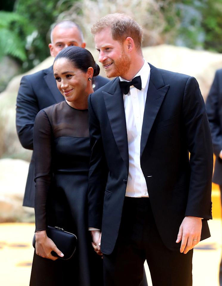 <p>Prince Harry and the Duchess of Sussex posed for photos together hand in hand. </p>
