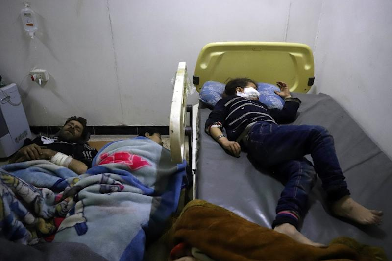 Wounded Syrians rest at a makeshift clinic in the Eastern Ghouta rebel enclave on March 17, 2018
