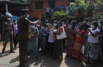 Family members of inmates gather demanding to know the condition of their relatives outside the Mahara prison complex following an overnight unrest in Mahara, outskirts of Colombo, Sri Lanka, Monday, Nov. 30, 2020. Sri Lankan officials say six inmates were killed and 35 others were injured when guards opened fire to control a riot at a prison on the outskirts of the capital. Two guards were critically injured. Pandemic-related unrest has been growing in Sri Lanka's overcrowded prisons. (AP Photo/Eranga Jayawardena)