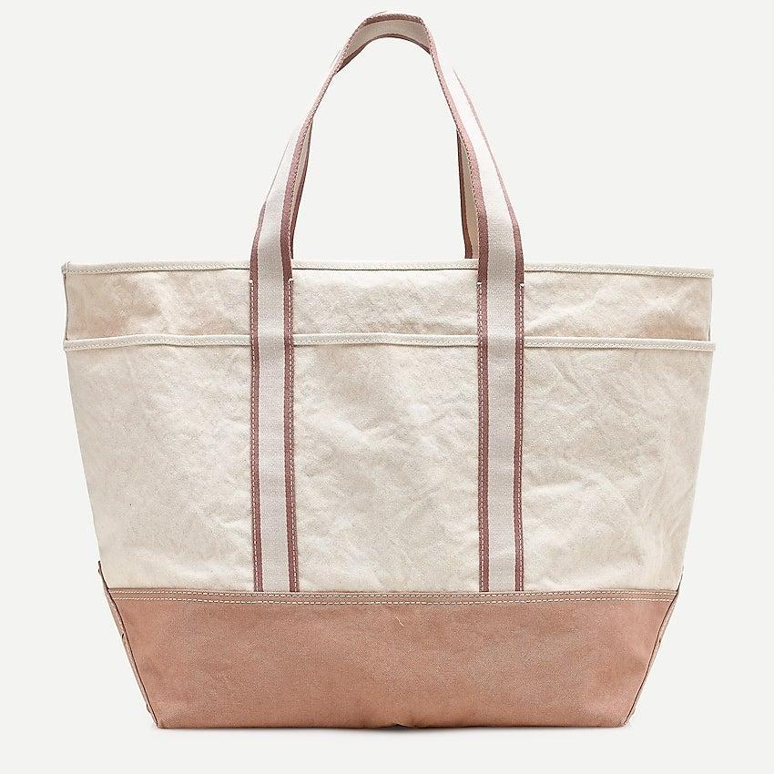 """<br><br><strong>J. Crew</strong> Large Montauk tote, $, available at <a href=""""https://go.skimresources.com/?id=30283X879131&url=https%3A%2F%2Fwww.jcrew.com%2Fp%2Fwomens%2Fcategories%2Faccessories%2Fbags%2Fmontauk%2Flarge-montauk-tote%2FAV810"""" rel=""""nofollow noopener"""" target=""""_blank"""" data-ylk=""""slk:J. Crew"""" class=""""link rapid-noclick-resp"""">J. Crew</a>"""