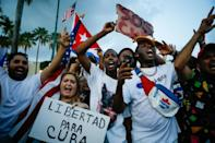 A woman holds a banner reading 'Freedom for Cuba' at a Miami rally supporting Cubans who have turned out in the largest popular protests since the 1959 revolution