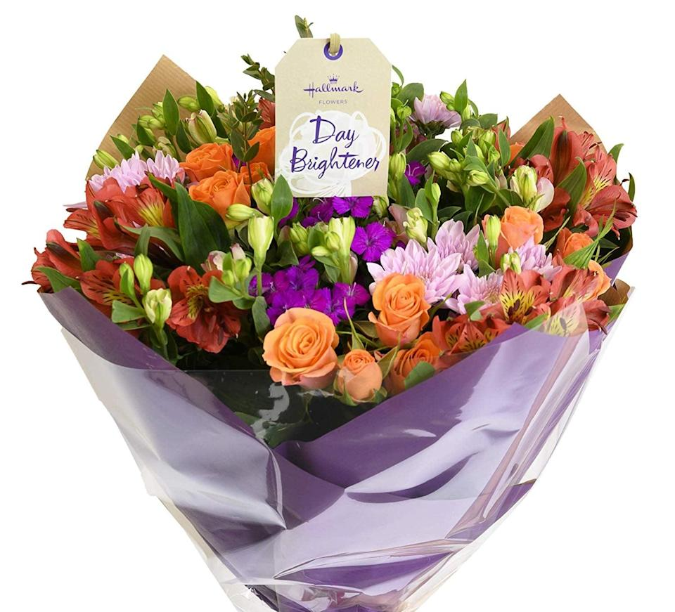 """<p>Gift your mom the <a href=""""https://www.popsugar.com/buy/Mother-Day-Charming-Bouquet-444291?p_name=Mother%27s%20Day%20Charming%20Bouquet&retailer=amazon.com&pid=444291&price=38&evar1=casa%3Aus&evar9=46127505&evar98=https%3A%2F%2Fwww.popsugar.com%2Fhome%2Fphoto-gallery%2F46127505%2Fimage%2F46128469%2FMother-Day-Charming-Bouquet&list1=shopping%2Cgift%20guide%2Cflowers%2Chouse%20plants%2Cplants%2Cmothers%20day%2Cgifts%20for%20women&prop13=api&pdata=1"""" class=""""link rapid-noclick-resp"""" rel=""""nofollow noopener"""" target=""""_blank"""" data-ylk=""""slk:Mother's Day Charming Bouquet"""">Mother's Day Charming Bouquet</a> ($38), and write a heartfelt letter to place in the center.</p>"""