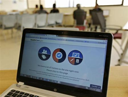 A busy screen is shown on the laptop of a Certified Application Counselor as he attempted to enroll an interested person for Affordable Care Act insurance, known as Obamacare, at the Borinquen Medical Center in Miami, Florida October 2, 2013. REUTERS/Joe Skipper