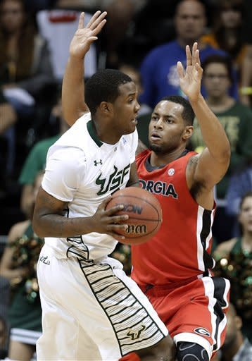 Georgia forward Marcus Thornton, right, stops South Florida forward Victor Rudd as he attempts to go to the basket during the first half of an NCAA college basketball game Friday, Nov. 30, 2012, in Tampa, Fla. (AP Photo/Chris O'Meara)