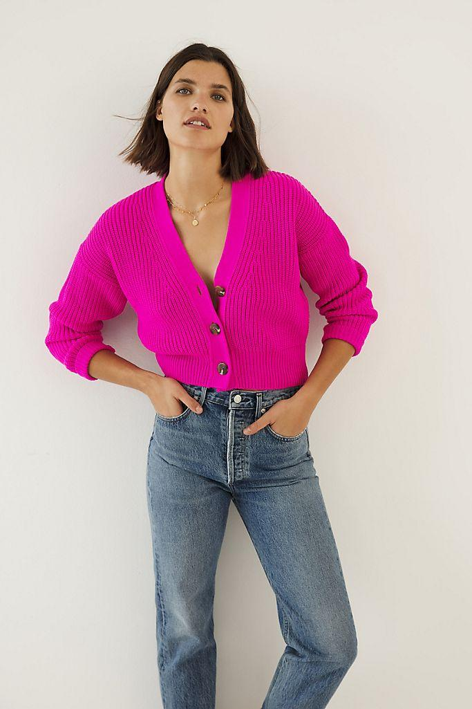 """<h2>Sunny Cropped Cardigan</h2><br>The sleek '90s silhouette of this cropped cardigan is kept decidedly un-minimal thanks to a splashy, shocking-pink hue.<br><br><strong>Maeve</strong> Sunny Cropped Cardigan, $, available at <a href=""""https://go.skimresources.com/?id=30283X879131&url=https%3A%2F%2Fwww.anthropologie.com%2Fshop%2Fsunny-cropped-cardigan%3Fcategory%3Dtops-sweaters%26color%3D068%26type%3DSTANDARD%26quantity%3D1"""" rel=""""nofollow noopener"""" target=""""_blank"""" data-ylk=""""slk:Anthropologie"""" class=""""link rapid-noclick-resp"""">Anthropologie</a>"""