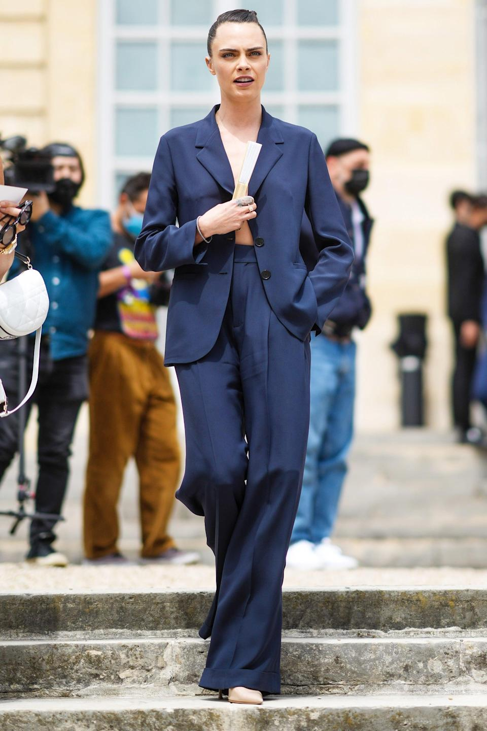 """Cara Delevingne's take on the naked summer trend includes leaving your shirt at home. <span class=""""copyright"""">Photo: Edward Berthelot/Getty Images.</span>"""