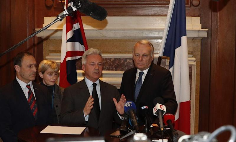 French foreign minister Jean-Marc Ayrault, right, with the UK foreign minister Alan Duncan, centre, in London, Thursday.