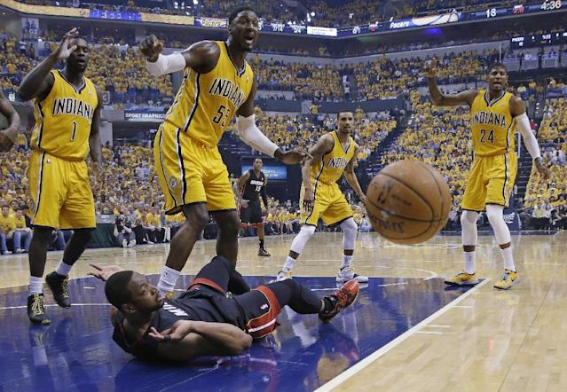 Miami Heat's Dwyane Wade (3) and Indiana Pacers' Roy Hibbert (55), Lance Stephenson (1) and Paul George (24) watch a loose ball during the first half of Game 2 of the NBA basketball Eastern Conference finals in Indianapolis, Tuesday, May 20, 2014. (AP Photo/Michael Conroy)