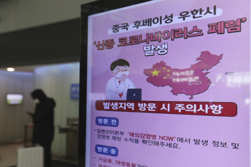 """A poster warning about coronavirus is displayed in a departure lobby at Incheon International Airport in Incheon, South Korea, Monday, Jan. 27, 2020. China on Monday expanded sweeping efforts to contain a viral disease by extending the Lunar New Year holiday to keep the public at home and avoid spreading infection. The sign reads """" A new coronavirus occurs in Wuhan City, China."""" (AP Photo/Ahn Young-joon)"""