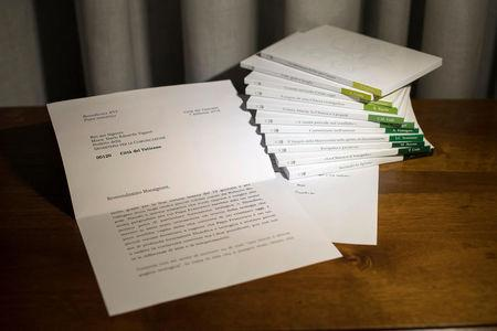 A series of 11 booklets on The Theology of Pope Francis and a letter from former Pope Benedict, which was read out at the presentation of the work, are seen at the Vatican in this undated handout photo obtained by Reuters March 15, 2018. Osservatore Romano/Handout via Reuters