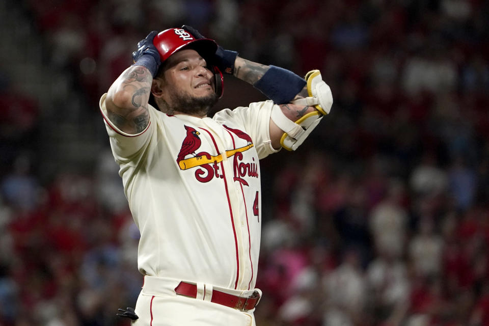St. Louis Cardinals' Yadier Molina reacts after flying out to end the fourth inning of a baseball game against the San Diego Padres Saturday, Sept. 18, 2021, in St. Louis. (AP Photo/Jeff Roberson)