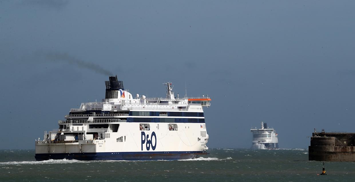 Ferries leave and arrive the Port of Dover in Kent, the day after Prime Minister Boris Johnson called on people to stay away from pubs, clubs and theatres, work from home if possible and avoid all non-essential contacts and travel in order to reduce the impact of the coronavirus pandemic.
