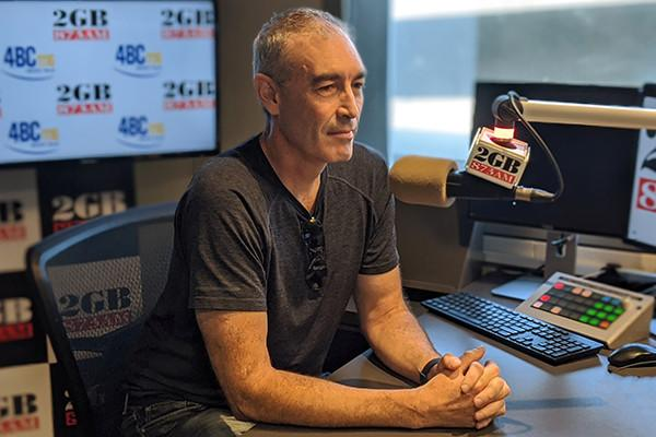 Yellow wiggle greg page giving interview at 2GB