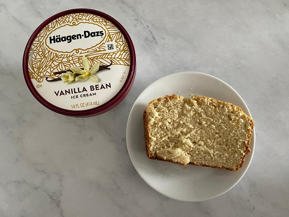 a pint of haagen-daaz vanilla ice cream beside a plated slice of the bread, all on a white countertop