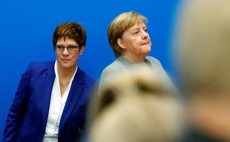 Outgoing leader of the Christian Democratic Union (CDU) Annegret Kramp-Karrenbauer and Germany's Chancellor Angela Merkel arrive for a board meeting at the party's headquarters in Berlin, Germany February 10, 2020. REUTERS/Hannibal Hanschke