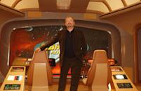 Former commander of the Starship Enterprise Captain Kirk (US actor William Shatner) sits on the bridge of a mock up of the Enterprise at Star Trek: The Adventure - an exhibition celebrating 35 years of the TV show and feature films - at Hyde Park.