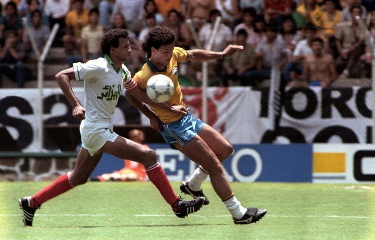 Algerian Lakhdar Belloumi (L) contests possession with Brazilian Careca during the 1986 World Cup in Mexico