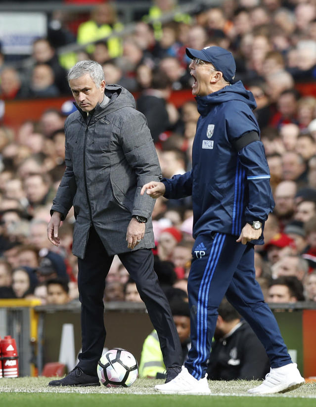 <p>Manchester United manager Jose Mourinho, left, and West Bromwich Albion manager Tony Pulis look on during the English Premier League soccer match at Old Trafford in Manchester, England, Saturday April 1, 2017. (Martin Rickett/PA via AP) </p>
