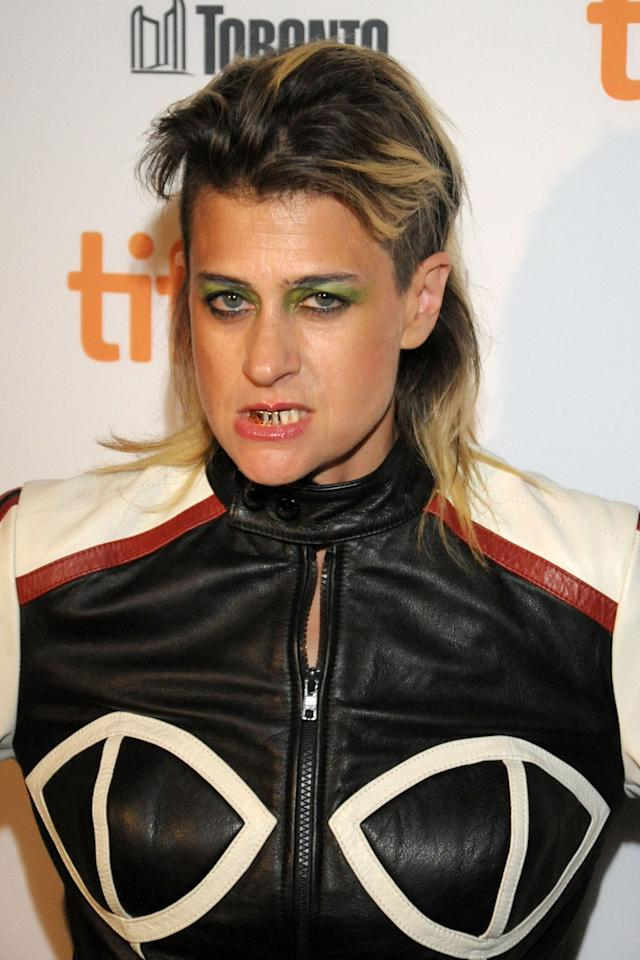 "Canadian musician and performance artist Peaches isn't known for her ladylike manners, so we expected nothing less than this snarl on the red carpet of her debut film ""Peaches Does Herself."""