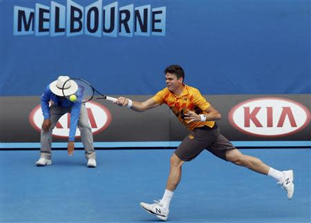 Milos Raonic of Canada hits a return to Grigor Dimitrov of Bulgaria during their men's singles match at the Australian Open 2014 tennis tournament in Melbourne January 18, 2014. REUTERS/Bobby Yip