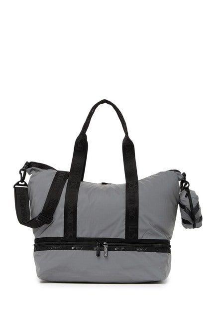 """<strong><h3><a href=""""https://www.nordstromrack.com/shop/product/2555861/le-sportsac-dakota-medium-deluxe-overnight-bag"""" rel=""""nofollow noopener"""" target=""""_blank"""" data-ylk=""""slk:LeSportsac Medium Overnight Bag"""" class=""""link rapid-noclick-resp"""">LeSportsac Medium Overnight Bag</a> </h3></strong><br>Breeze your way through a one to two-day stay in style with this deluxe overnight bag — made from durable and stylish textiles with multi pockets, compartments, and convertible straps for super streamlined travels.<br><br><strong>LeSportsac</strong> Dakota Medium Deluxe Overnight Bag, $, available at <a href=""""https://go.skimresources.com/?id=30283X879131&url=https%3A%2F%2Fwww.nordstromrack.com%2Fshop%2Fproduct%2F2555861%2Fle-sportsac-dakota-medium-deluxe-overnight-bag"""" rel=""""nofollow noopener"""" target=""""_blank"""" data-ylk=""""slk:Nordstrom Rack"""" class=""""link rapid-noclick-resp"""">Nordstrom Rack</a>"""