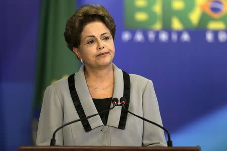 Brazil's President Dilma Rousseff reacts during the signing ceremony of the Civil Procedure Code, at the Planalto Palace in Brasilia