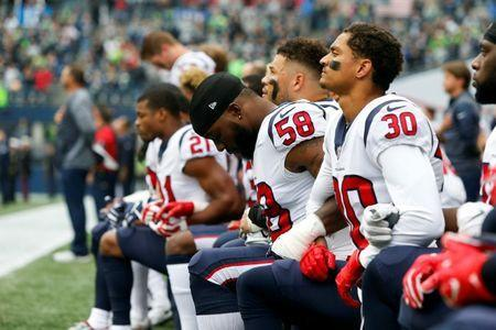 Houston Texans linebacker Lamarr Houston and cornerback Kevin Johnson kneel during the anthem, October 29, 2017. Mandatory Credit: Joe Nicholson-USA TODAY Sports