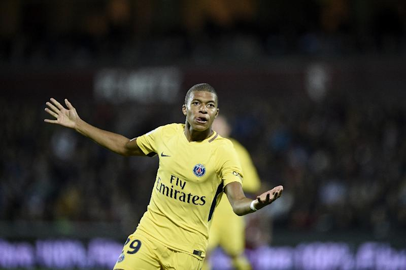 Mbappe opens account on PSG debut in facile win over Metz