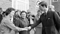 Charles meeting Miss E. Davies (l), the canteen supervisor of the University College of Wales, Aberystwyth, when he arrived at Pantycelyn Hall of Residence at the college. Dr Edward Ellis behind the Prince, was the Warden of Pantycelyn Hall. (PA Images)