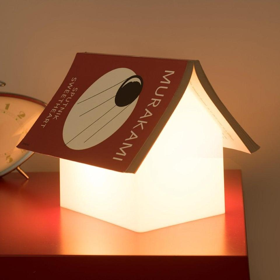 <p>Keep your place in your book by placing it on this <span>Suck UK Bookrest Lamp </span> ($90), because no one likes to lose the page they left off.</p>