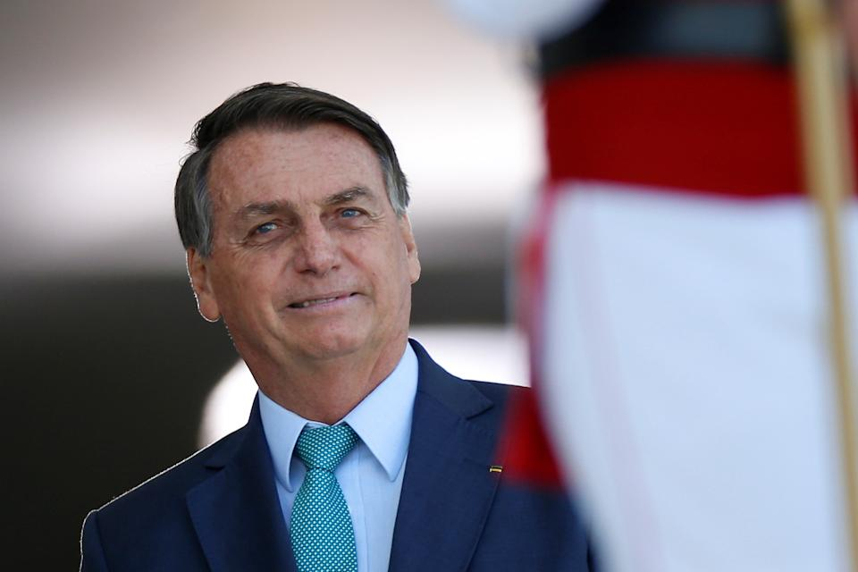 Brazil's President Jair Bolsonaro looks on before welcoming his counterpart Cabo Verde's President Jorge Carlos Fonseca at the Planalto Palace in Brasilia, Brazil, July 30, 2021. REUTERS/Adriano Machado