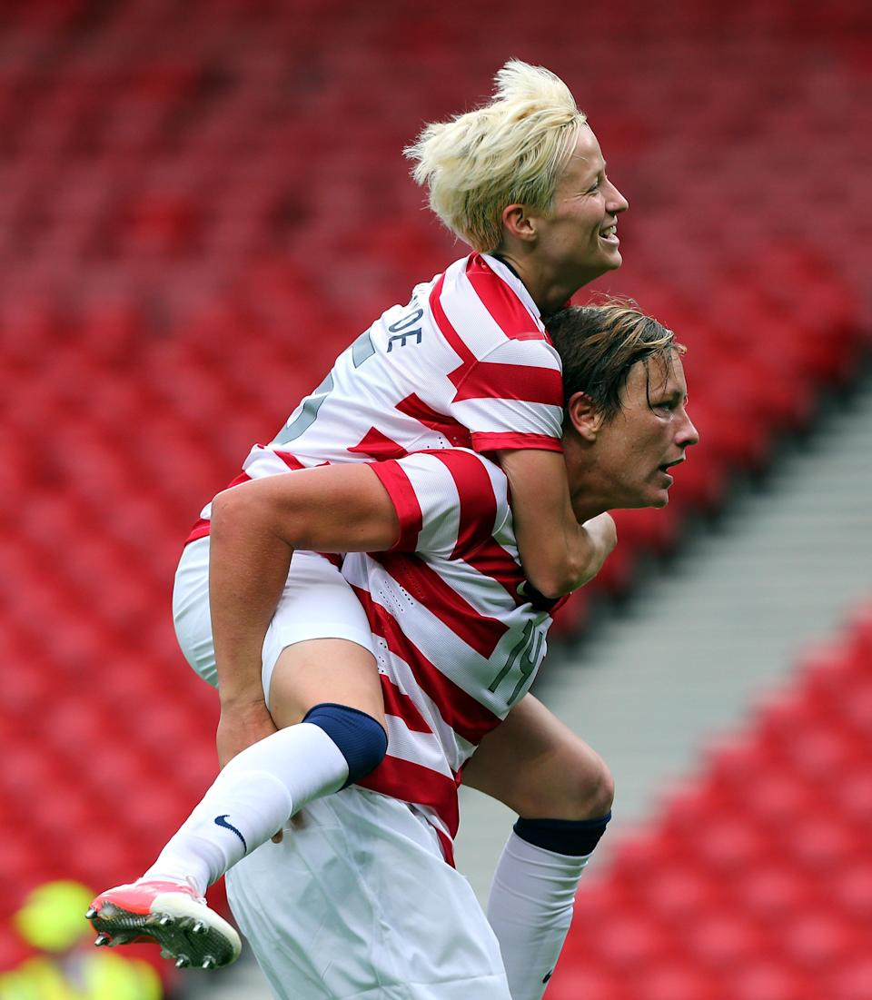 GLASGOW, SCOTLAND - JULY 28: Abby Wambach of USA celebrates with Megan Ropinoe after scoring against Columbia during the Women's Football first round Group G match between United States and Colombia on Day 1 of the London 2012 Olympic Games at Hampden Park on July 28, 2012 in Glasgow, Scotland. (Photo by Stanley Chou/Getty Images)