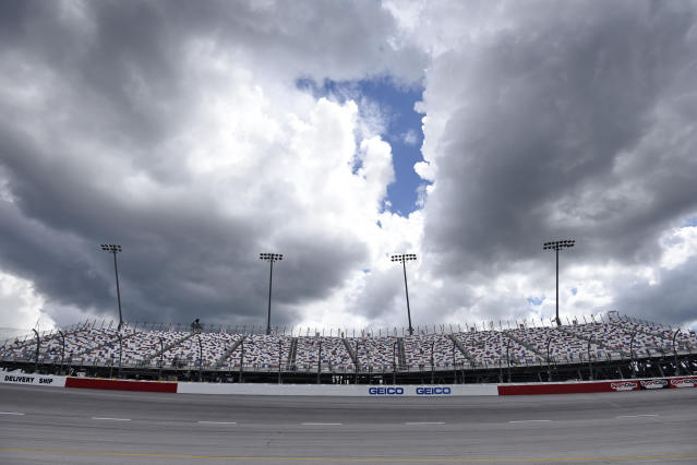 Clouds begin to gather over the grandstand at Turn 1 before a NASCAR Cup Series auto race Sunday, Sept. 1, 2019, at Darlington Raceway in Darlington, S.C. (AP Photo/Richard Shiro)
