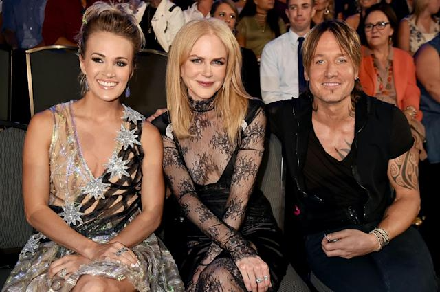 <p>(L-R) Carrie Underwood, Nicole Kidman and Keith Urban in the audience during the 2017 CMT Music Awards at the Music City Center on June 7, 2017 in Nashville, Tennessee. (Photo by Jeff Kravitz/FilmMagic) </p>