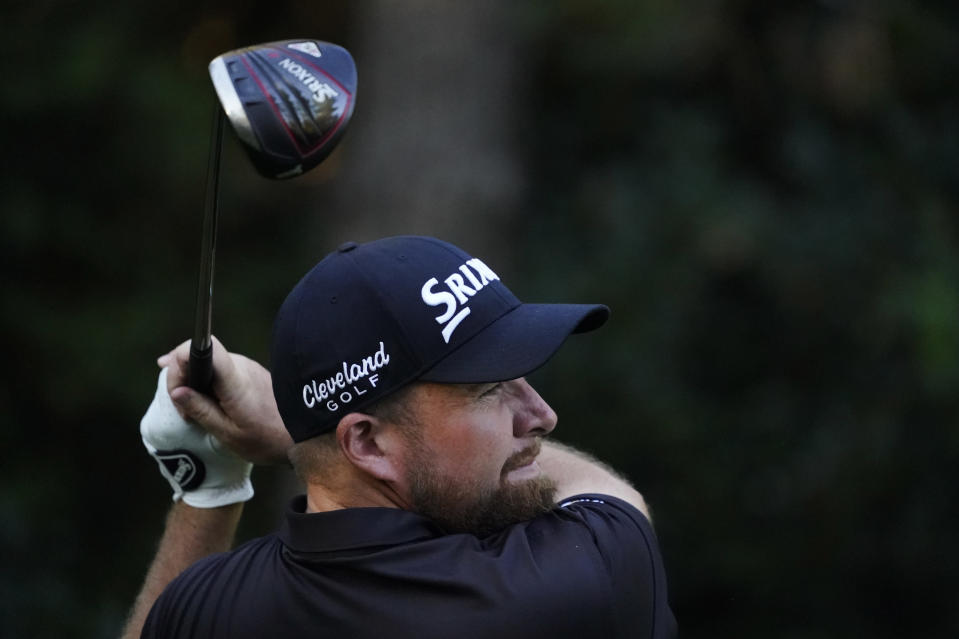 Shane Lowry, of Ireland, watches his tee shot on the seventh hole during the second round of the Masters golf tournament Friday, Nov. 13, 2020, in Augusta, Ga. (AP Photo/Charlie Riedel)