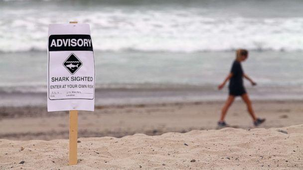 PHOTO: Warning signs are placed along the beach to warn swimmers and surfers of recent shark sightings in San Clemente, Calif., May 23, 2017. (Reuters via Newscom, FILE)