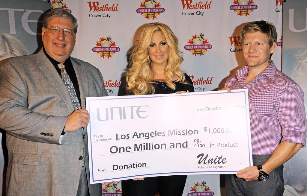 """At the end of the event, Kim -- who never leaves home without her wig -- presented a donation for $1 million worth of UNITE Hair Care product to the Los Angeles Mission, which serves the homeless living on the streets of downtown L.A. Jean Baptiste Lacroix/<a href=""""http://www.wireimage.com"""" target=""""new"""">WireImage.com</a> - October 19, 2010"""