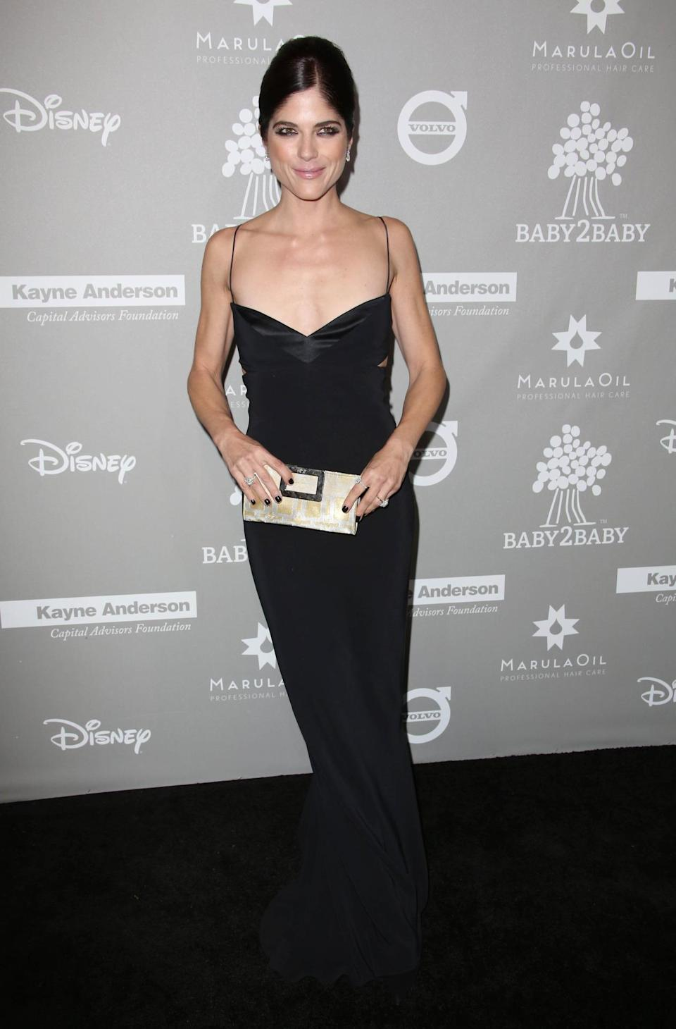 Selma Blair looked stunning in a slinky Narciso Rodriguez number. She actress and mum-of-one paired the dress with Harry Winston earrings and a box clutch. [Photo: Rex]