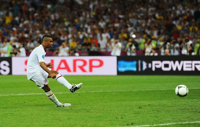 <p>Ashley Cole slides in to deliver his fateful spot-kick against Italy… </p>
