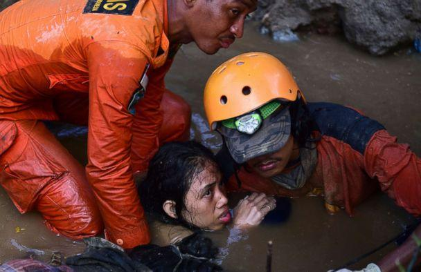 PHOTO: Rescuers try to rescue a 15-year old earthquake victim Nurul Istikharah from her damaged house following earthquakes and tsunami in Palu, Central Sulawesi, Indonesia, Sept. 30, 2018. (Arimacs Wilander/AP)