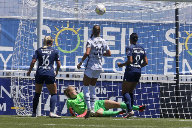 Portland Thorns FC goalkeeper Bella Bixby looks on as North Carolina Courage forward Lynn Williams (9) scores against her during the second half of an NWSL Challenge Cup soccer match at Zions Bank Stadium Saturday, June 27, 2020, in Herriman, Utah. (AP Photo/Rick Bowmer)