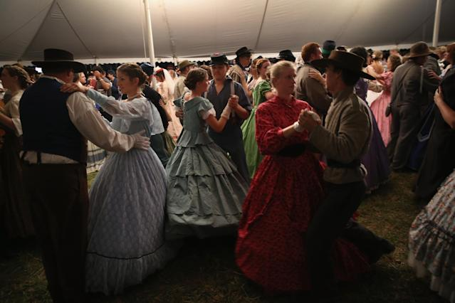 GETTYSBURG, PA - JUNE 29: American Civil War re-enactors dance during an evening ball while taking a break from a three-day Battle of Gettysburg re-enactment on June 29, 2013 in Gettysburg, Pennsylvania. Some 8,000 re-enactors from the Blue Gray Alliance are participating in events marking the 150th anniversary of the July 1-3, 1863 Battle of Gettysburg. General Robert E. Lee's Army of Northern Virginia was defeated on the third day of the battle, considered the turning point in the American Civil War and a watershed moment in the nation's history. Union and Confederate armies suffered a combined total of some 46,000-51,000 casualties over three days, the highest of any battle the four-year war. (Photo by John Moore/Getty Images)