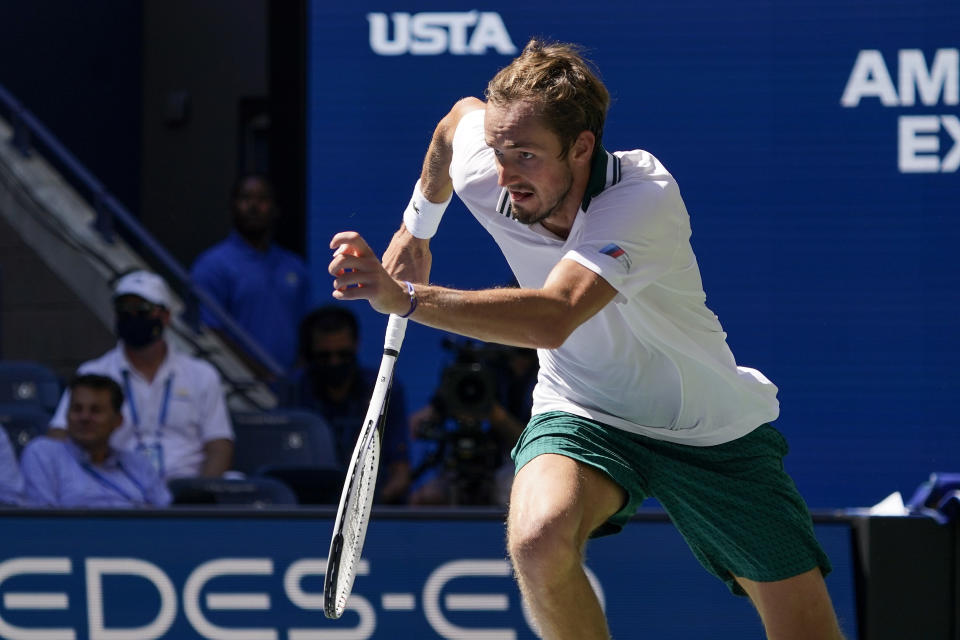 Daniil Medvedev, of Russia, chases down a shot from Botic Van de Zandschulp, of the Netherlands, during the quarterfinals of the US Open tennis championships, Tuesday, Sept. 7, 2021, in New York. (AP Photo/Elise Amendola)