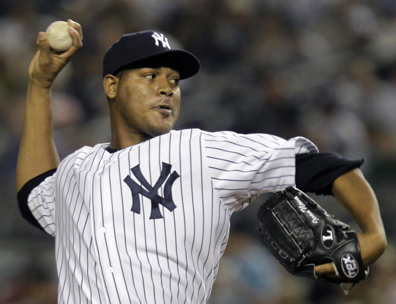 New York Yankees starting pitcher Ivan Nova winds up in the first inning against the Los Angeles Angels during their baseball game at Yankee Stadium in New York, Sunday, April 15, 2012. (AP Photo/Kathy Willens)