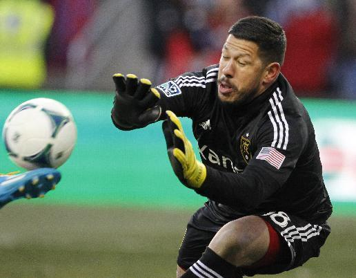 Real Salt Lake goalkeeper Nick Rimando attempts to block a shot by Sporting Kansas City during the first half of the MLS Cup final soccer match in Kansas City, Kan., Saturday, Dec. 7, 2013. (AP Photo/Colin E. Braley)