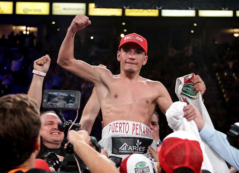 CARSON, CA - SEPTEMBER 09: Juan Francisco Estrada of Mexico celebrates his victory over Carlos Cuadras of Mexico at StubHub Center on September 9, 2017 in Carson, California. (Photo by Jeff Gross/Getty Images)